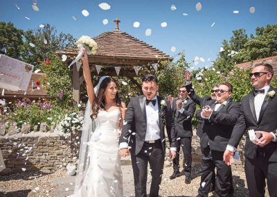 Best wedding confetti photograph ever thrown confetti box outdoor wedding venue in Dorset by one thousand words photography