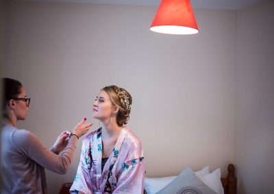 Bridal makeup artist wedding morning preparation photograph by one thousand words Dorset documentary wedding photographers