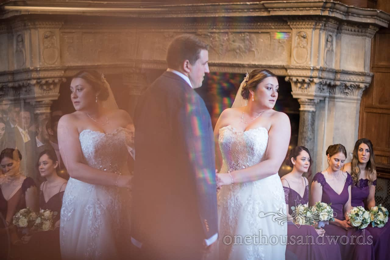 Bride and groom reflection during New Forest hotel wedding ceremony at Rhinefield Hotel by one thousand words photography