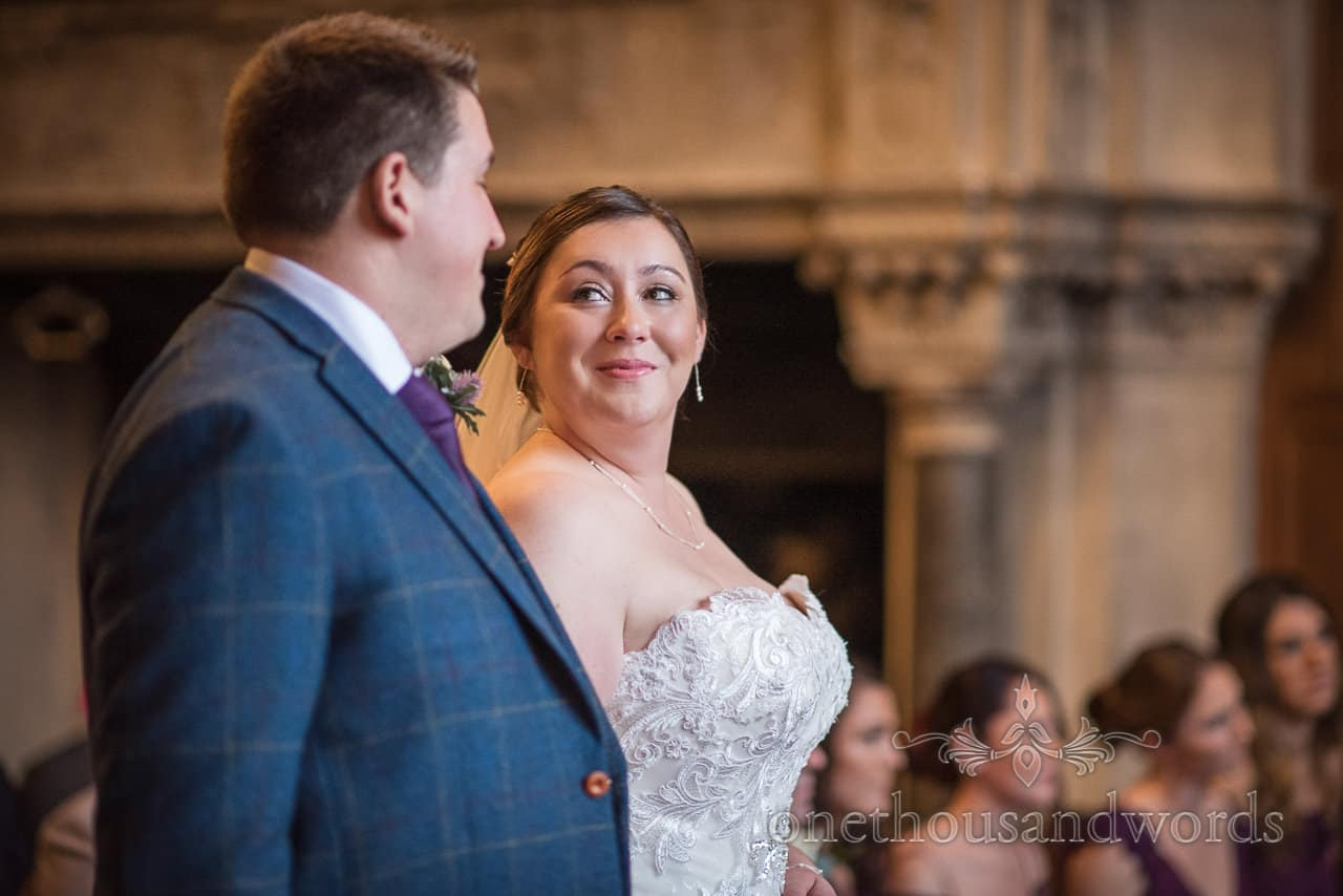 Bride looks at groom during Rhinefield House hotel marriage ceremony photograph