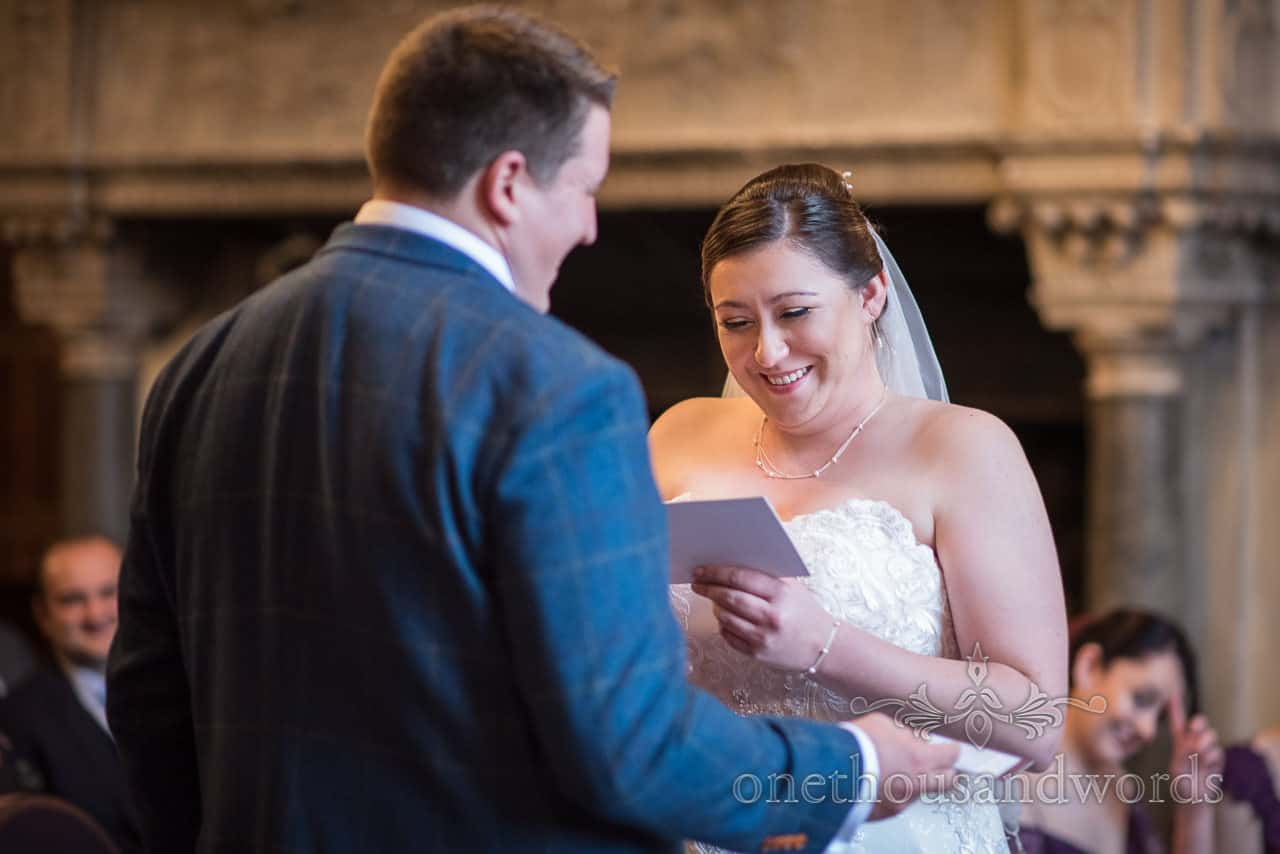 Bride reads wedding vows to groom and laughs at ceremony during New Forest hotel wedding