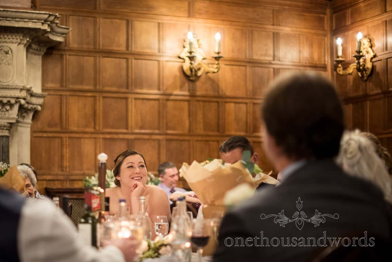 Happy bride smiling during Rhinefield House New Forest Hotel wedding speeches by one thousand words photography