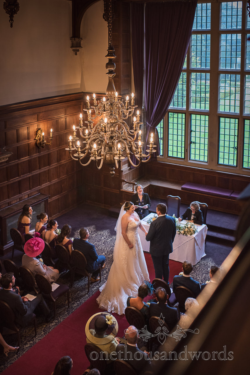 Civil ceremony at New Forest hotel wedding in the Great Hall at Rhinefield House