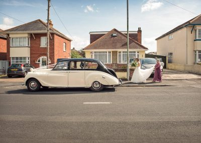 Classic wedding car outside family home on wedding morning photograph by one thousand words photography in Dorset