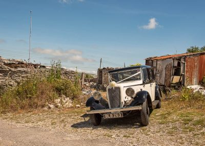 Classic wedding car in ruined rural countryside setting wedding photograph by Dorset wedding photographers