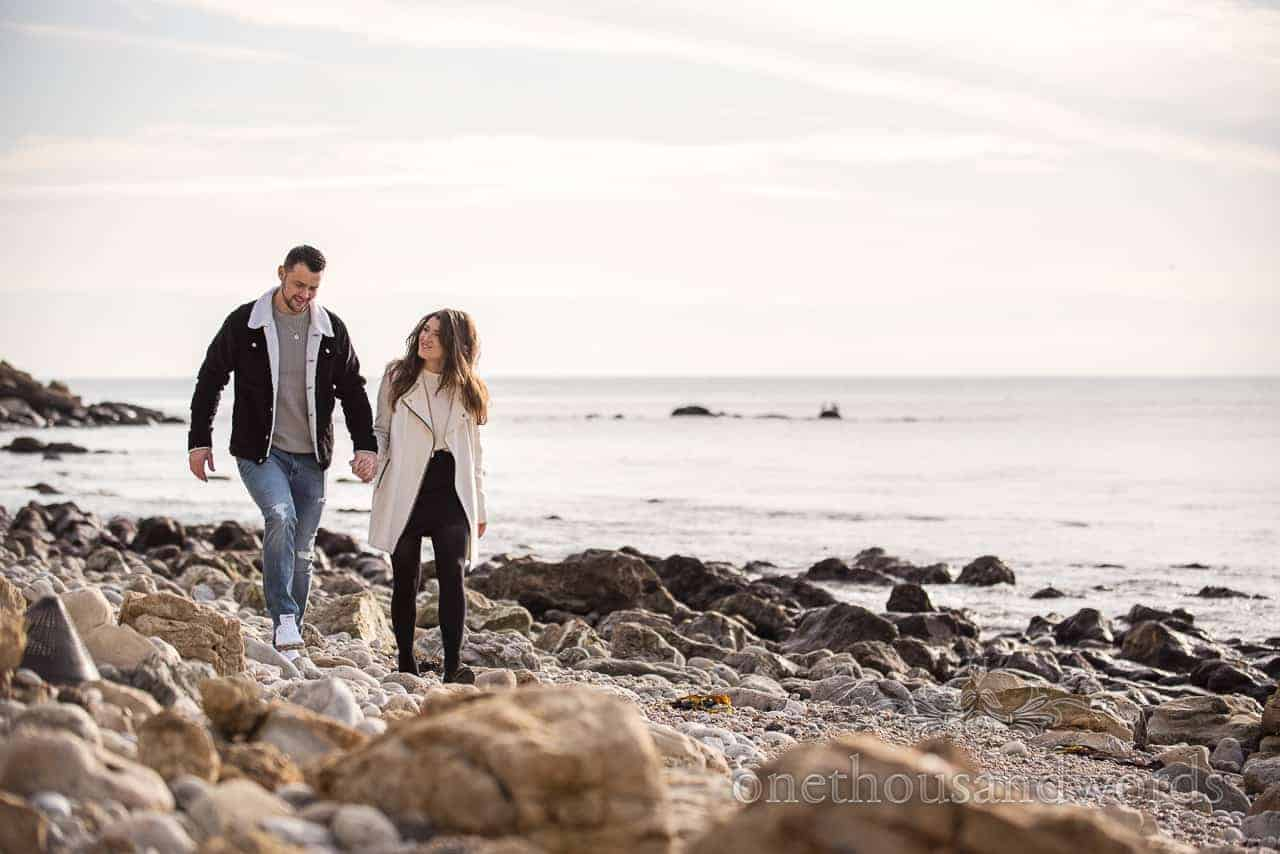 Couple wear coordinated clothing for top tips for engagement photos