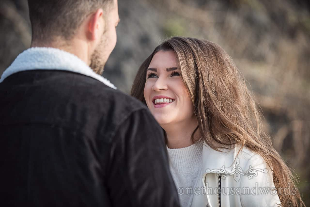 Engagement portrait photograph by one thousand words of happy bride to be laughing at her future husband