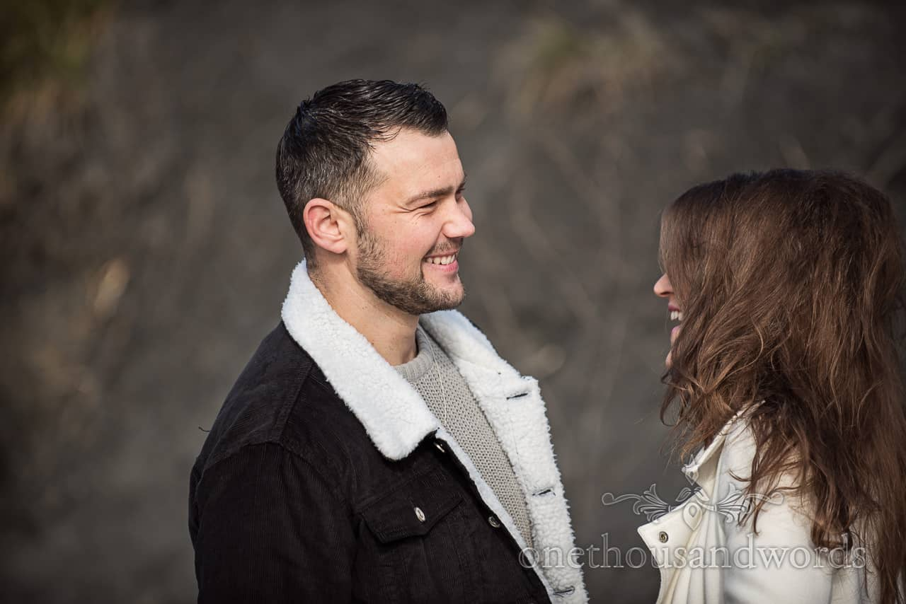 Engagement portrait photograph by one thousand words of happy groom to be laughing at his future wife