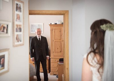 Father of the bride takes first look at bride on wedding morning photograph by one thousand words documentary photography