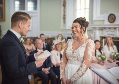 Groom reads wedding vows to bride at civil wedding ceremony in Bournemouth town hall by Dorset wedding photographers