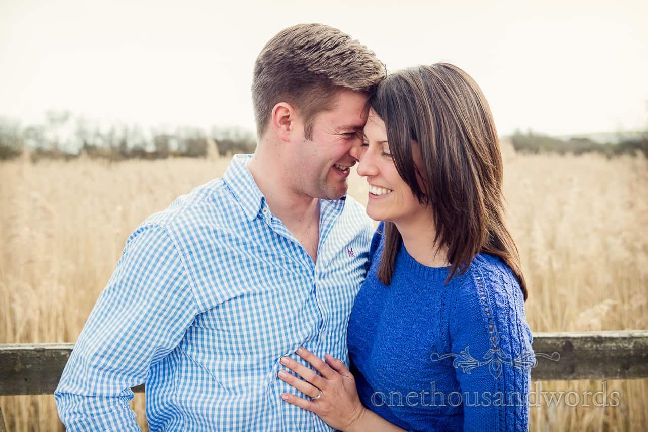 Happy couple at Dorset beach engagement photographs