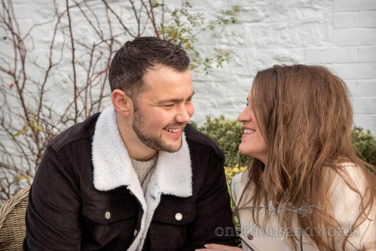 Happy couple smiling photograph at the Smugglers Inn pub in Dorset by one thousand words documentary wedding photography