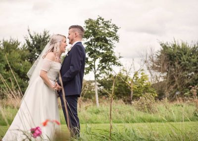 Natural wedding photograph of bride and groom laughing together in couple photo at Dorset countryside wedding