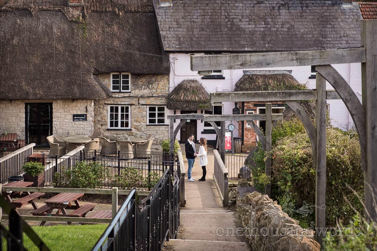 Osmington Mills engagement photographs couple at Smugglers Inn Dorset pub by one thousand words wedding photography