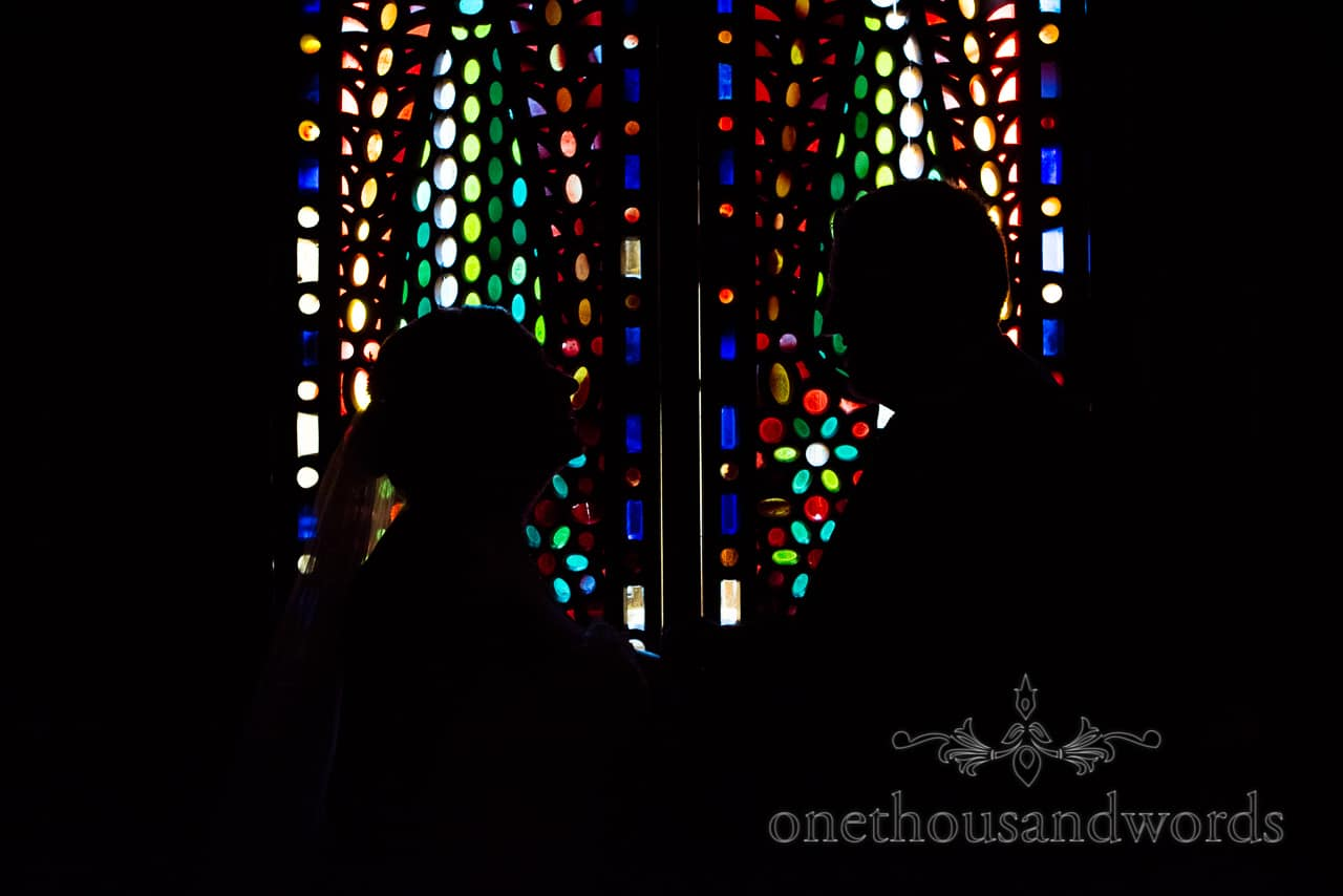 Silhouetted bride and groom in Alhambra Room At Rhinefield House New Forest hotel wedding venue by one thousand words