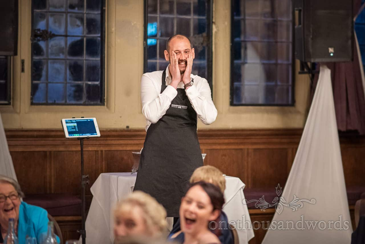 Singing waiter act entertains wedding guests At Rhinefield house hotel wedding venue in Hampshire