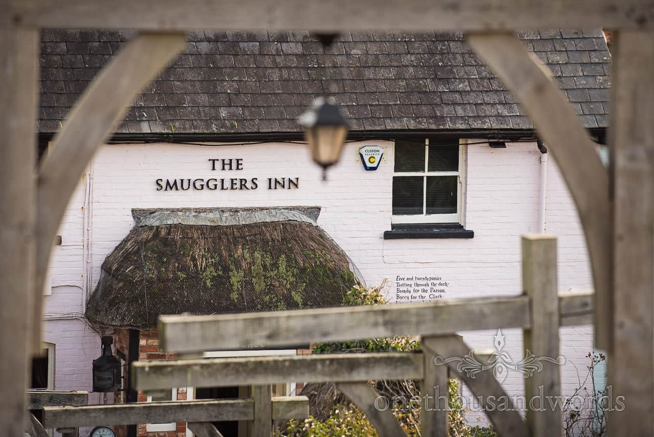 Smugglers Inn pub sign lettering at Osmington Mills Dorset photograph by one thousand words documentary wedding photography