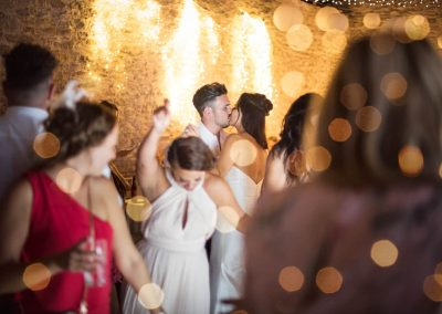 Stunning documentary wedding photograph of wedding kiss on Dorset wedding venue dance floor with lighting bokeh