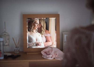 Stunning wedding bridal preparation photograph of brides portrait reflection in mirror on wedding morning by Dorset photographers
