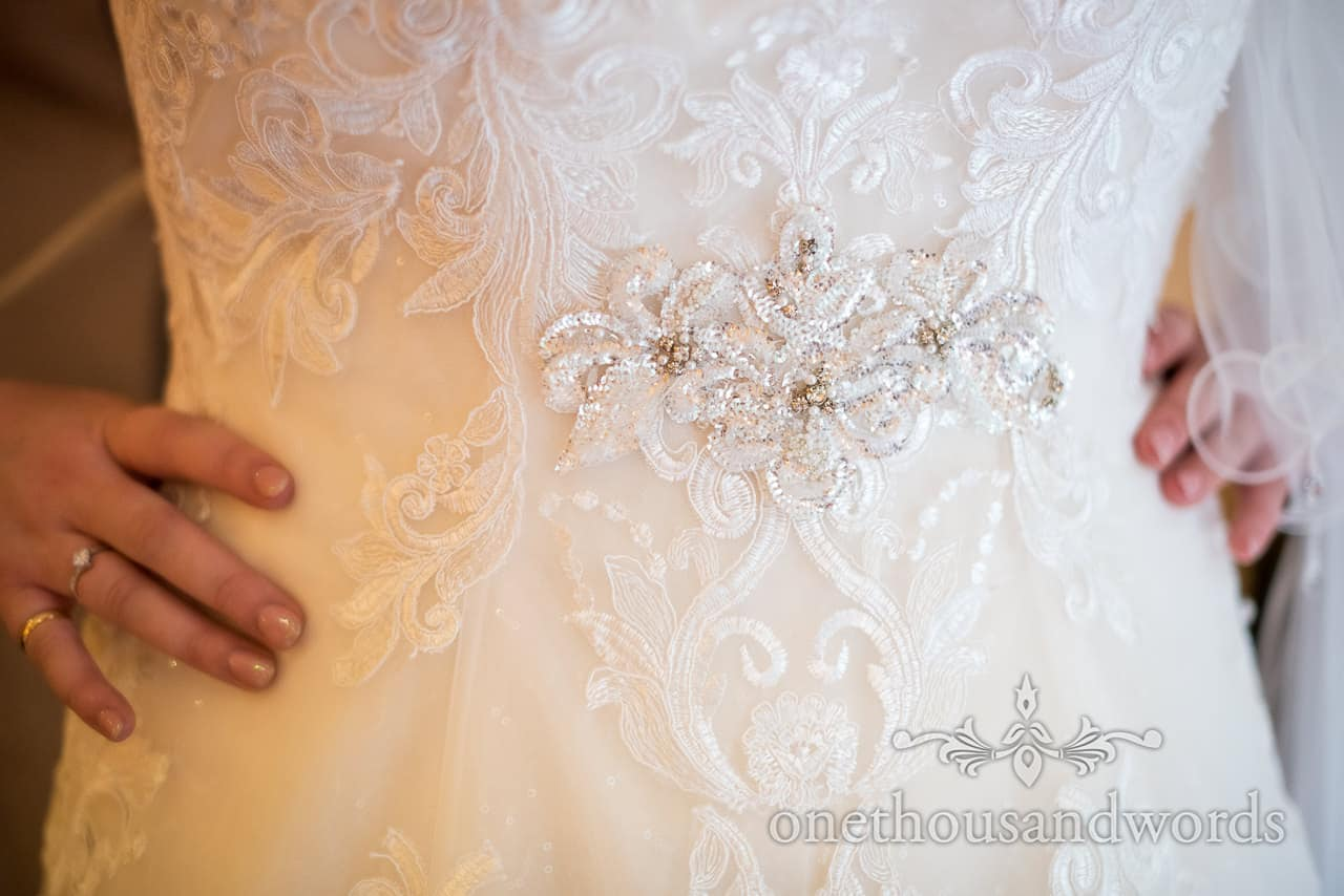 White wedding dress detail photograph bride with hands on hips documentary wedding photo by one thousand words photography