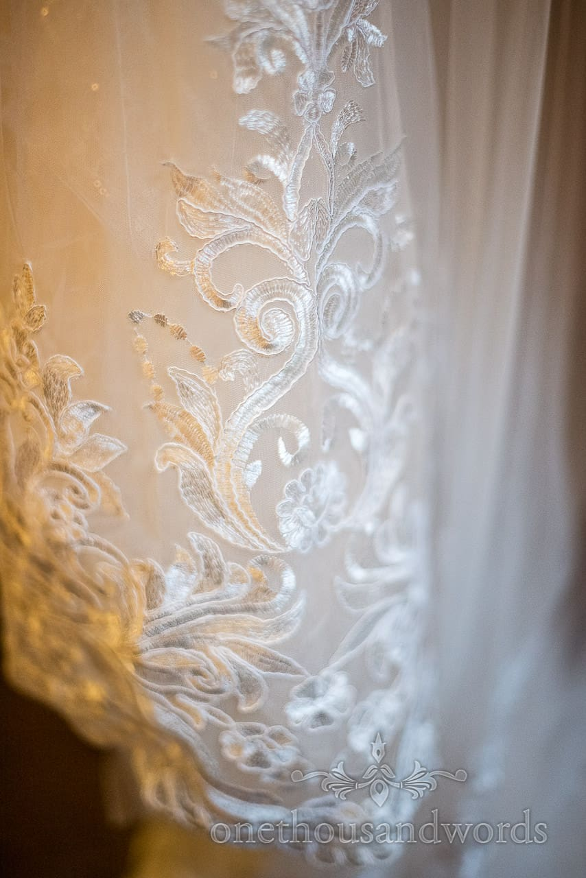Close Up Detail Photograph Of Wedding Dress Intricate Lace Patterns