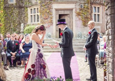 Wedding exchange vows and rings outdoor wedding ceremony photograph at Walton Castle wedding venue in Bristol