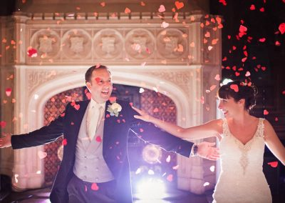 Wedding bride and groom first dance red love heart confetti at Canford School photograph with white light burst