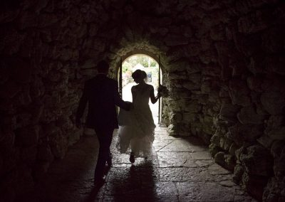 Wedding photograph of bride and groom in stone tunnel at the Italian Villa in Dorset by one thousand words wedding photography