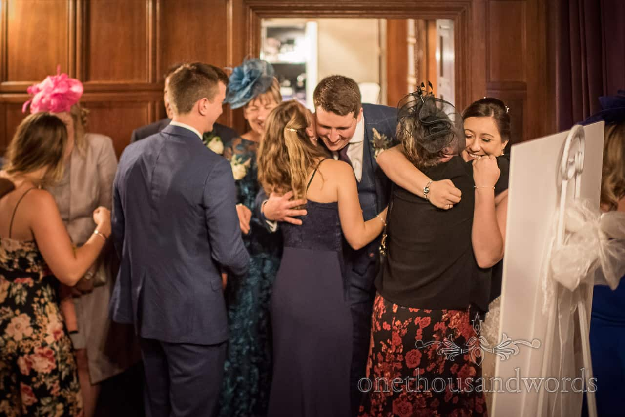 Wedding Receiving Line At Rhinefield House Hotel With Bride And Groom Hugging Guests Entering Wedding Breakfast