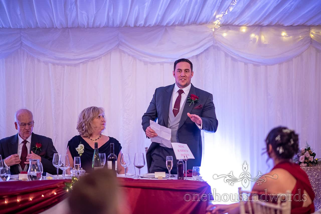 Top table as Best man delivers speech at Smedmore House marquee wedding reception