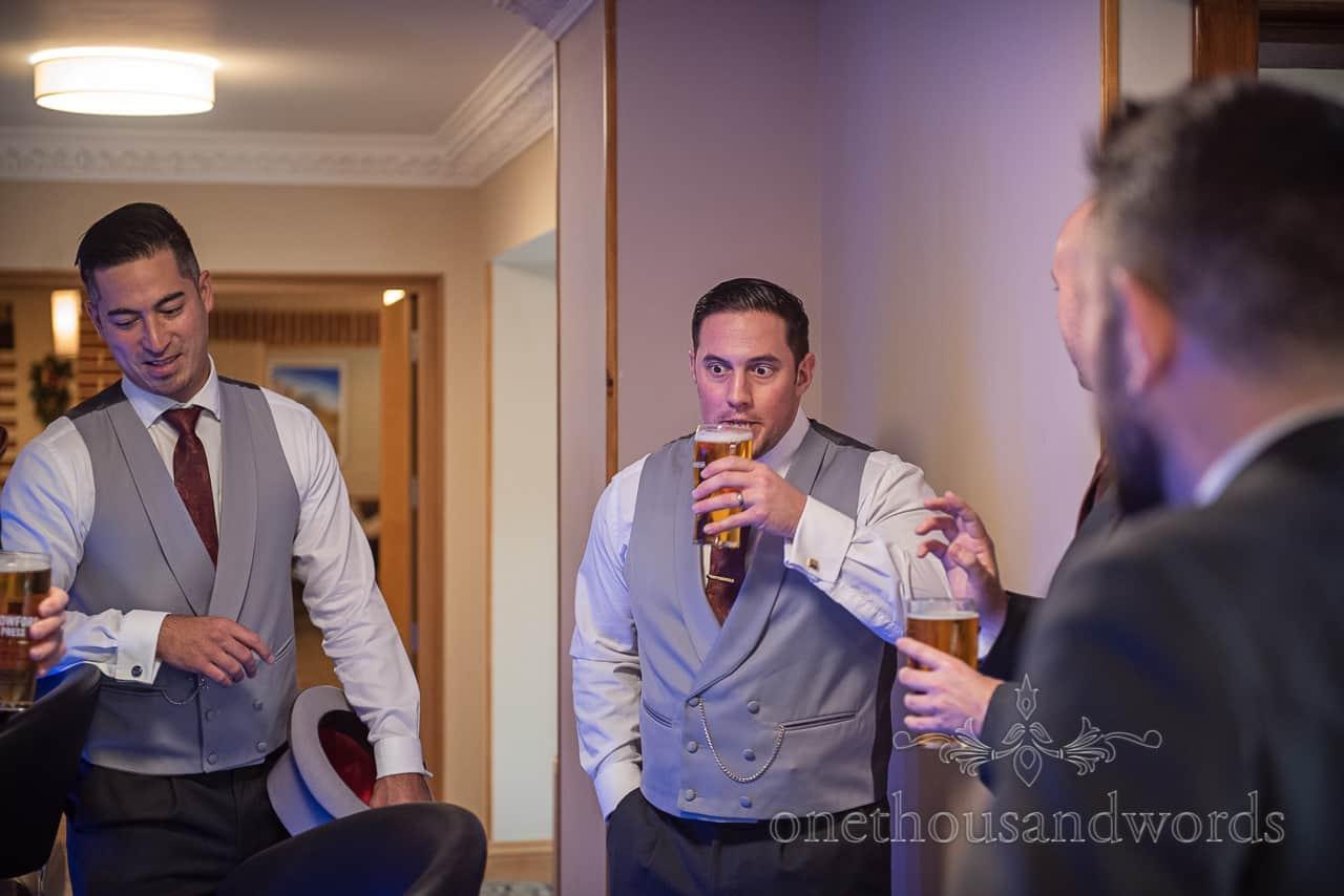 Best man and groomsmen enjoy drink at hotel bar before Smedmore House wedding