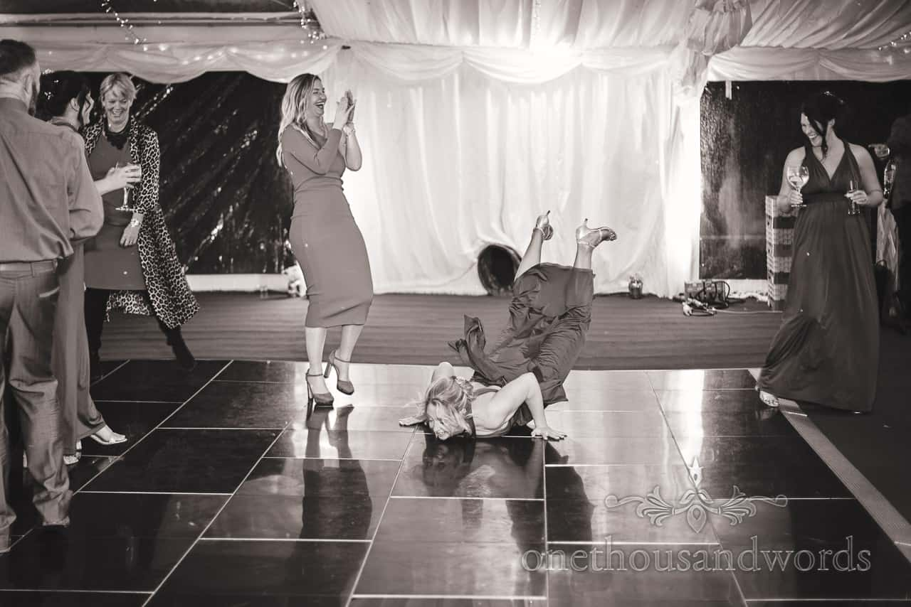 Break dancing bridesmaid showing her moves at Smedmore marquee wedding reception