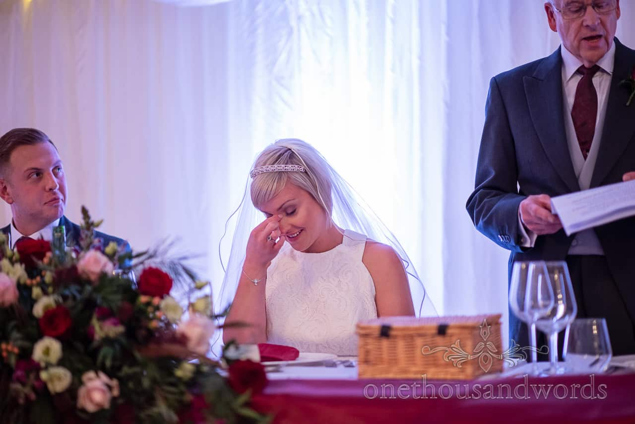 Bridal reaction during fathers speech at Smedmore House marquee wedding reception