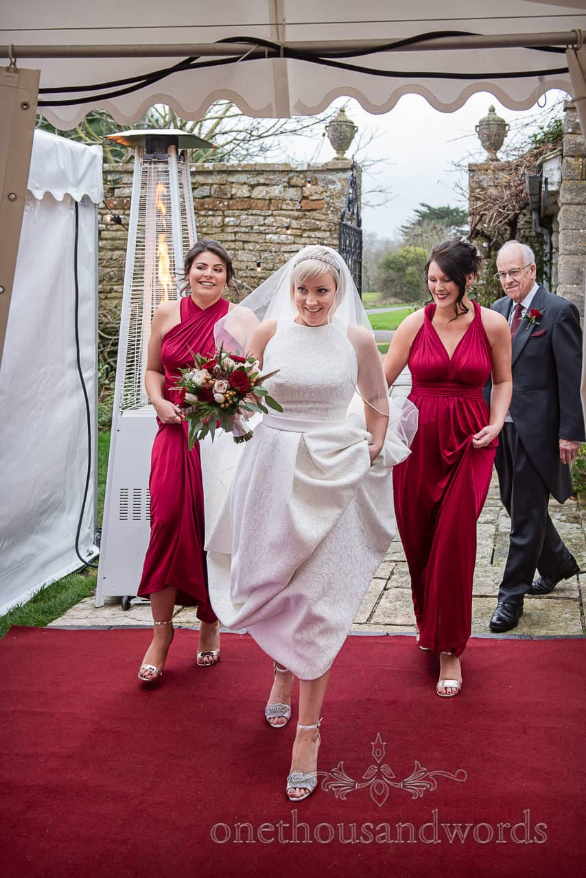Bride, bridesmaids and father of the bride Enter marquee at Smedmore House wedding