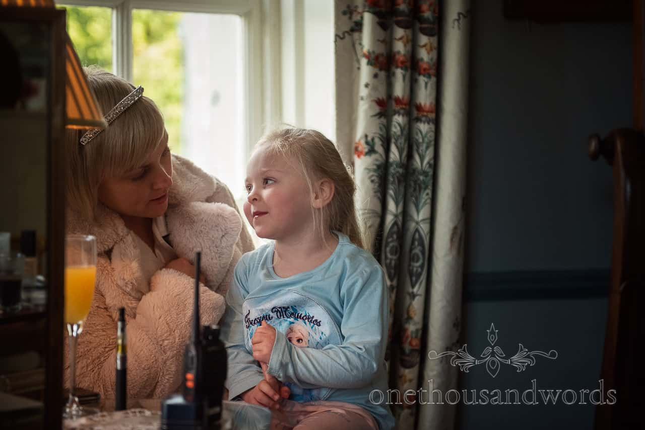 Bride and flower girl during Smedmore House wedding morning