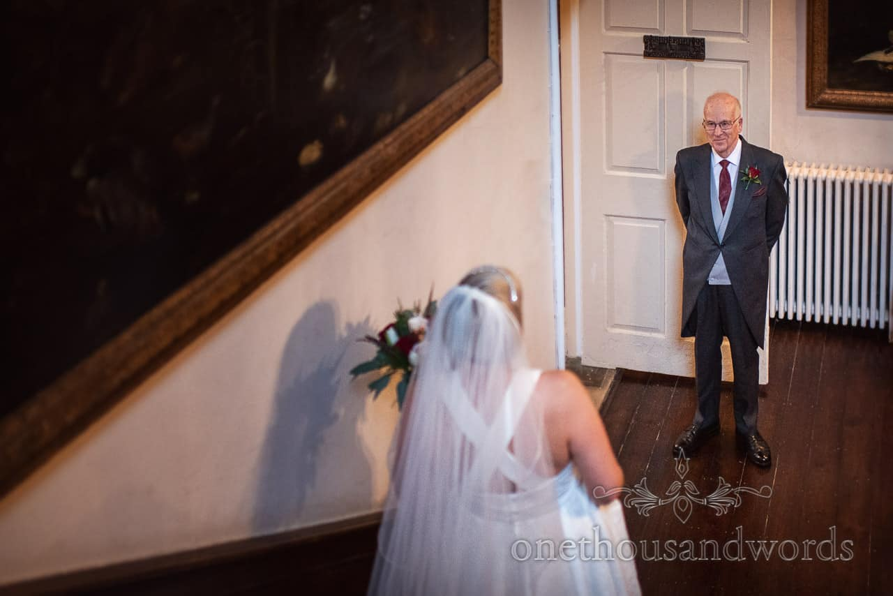 Bride is greeted by father at Smedmore House wedding photographs