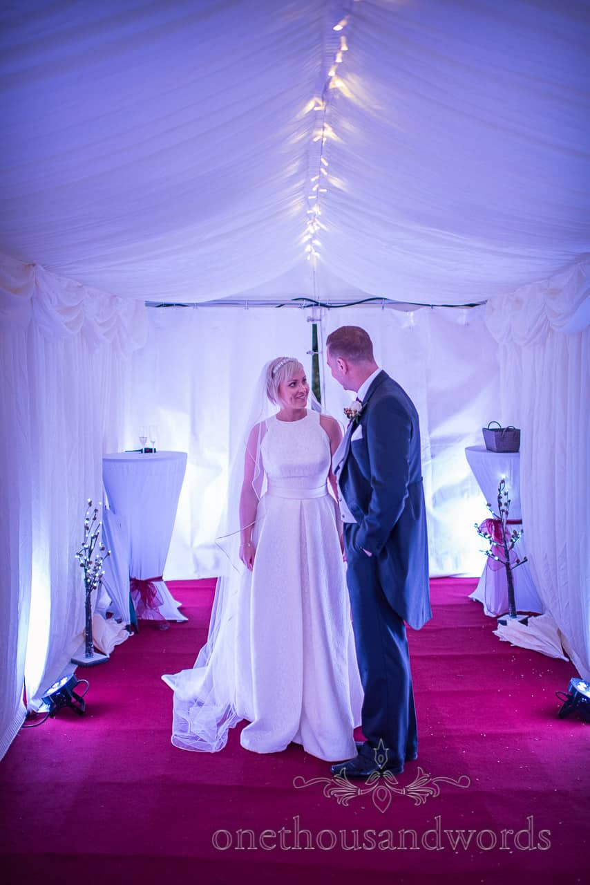 Bride and groom about to enter marquee at Smedmore House wedding
