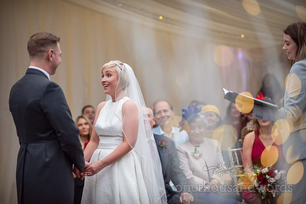 Bride and groom make their promises Smedmore House marquee wedding ceremony