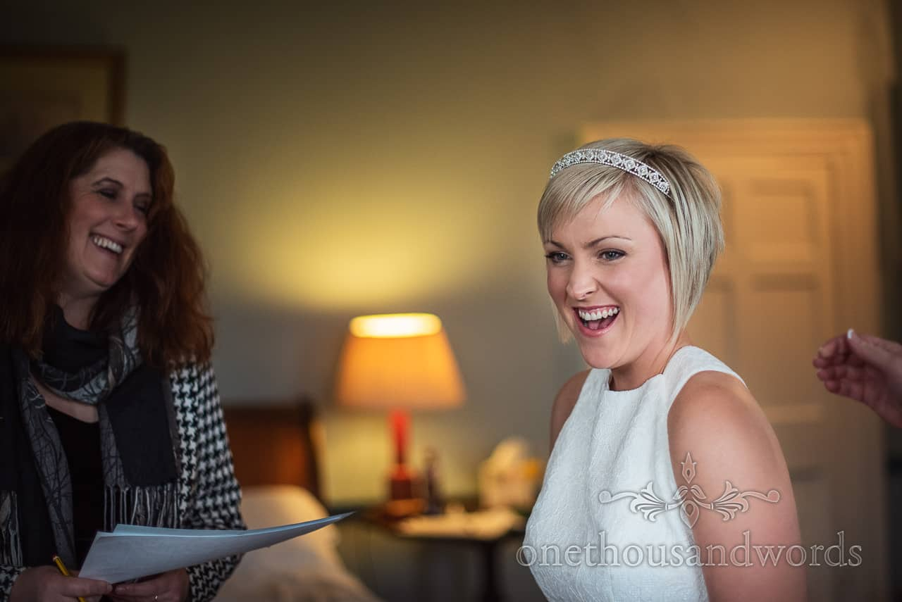 Bride laughs with registrar at Smedmore House wedding photographs