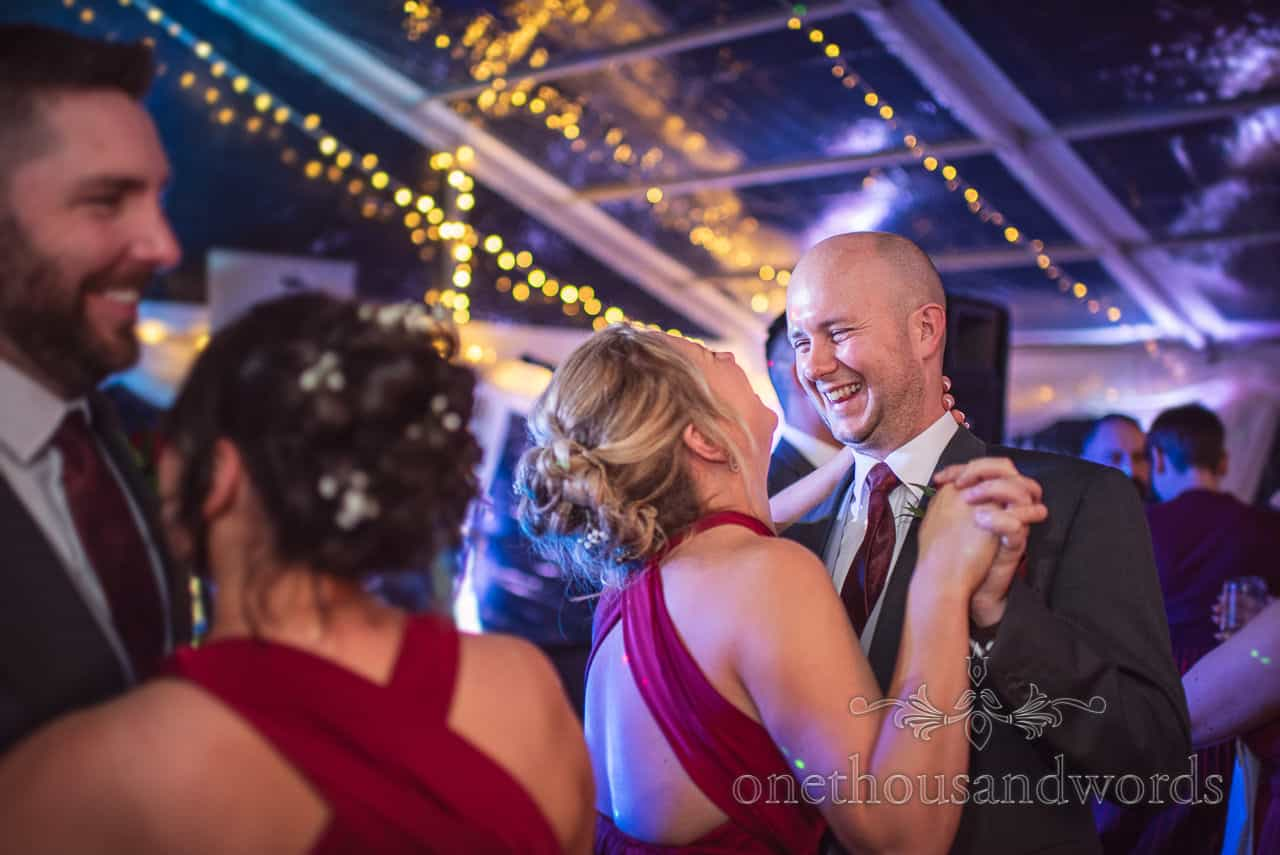 Bridesmaids and groomsmen dance during Smedmore House marquee wedding reception