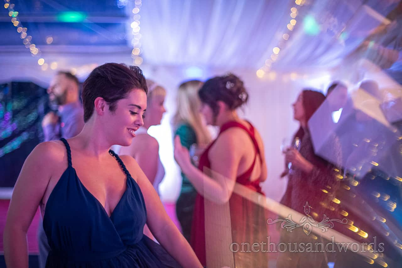 Dancing guest in blue dress at Smedmore Marquee wedding evening