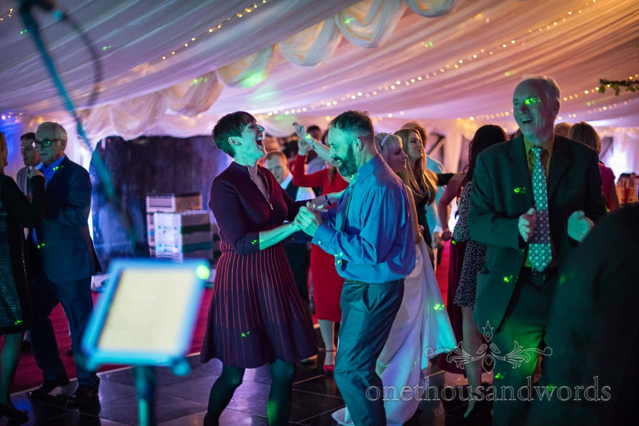 Dancing guests at Smedmore House marquee wedding reception