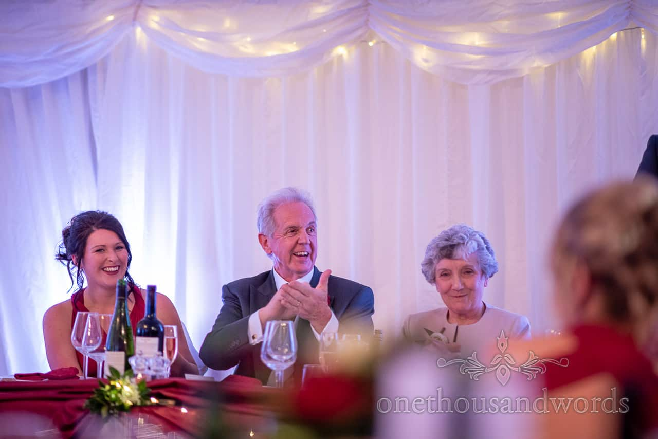 Father of the groom reaction during speech at Smedmore House wedding marquee reception