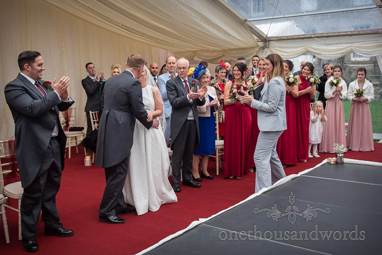 First kiss reactions at Smedmore House marquee wedding ceremony
