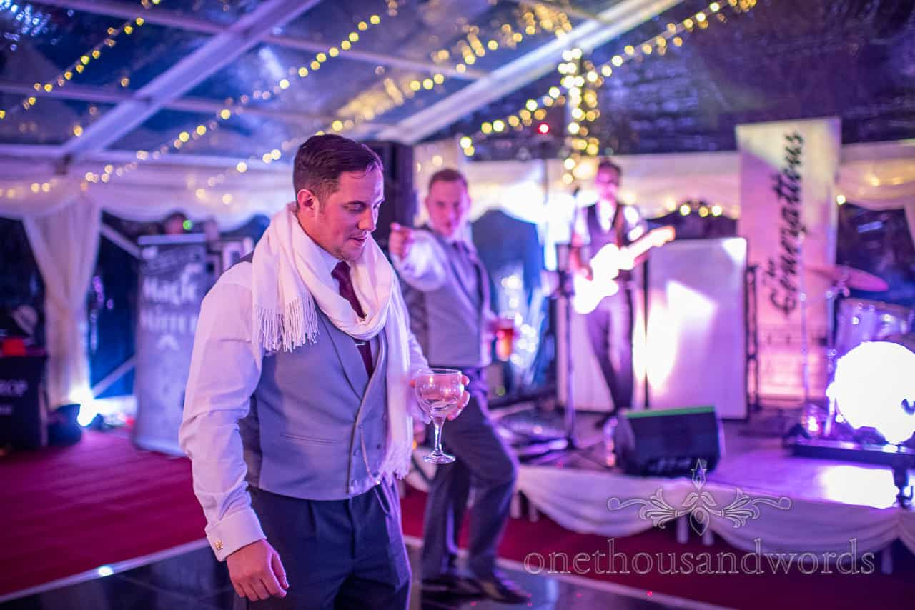 Groom and best man dancing during Smedmore marquee wedding evening