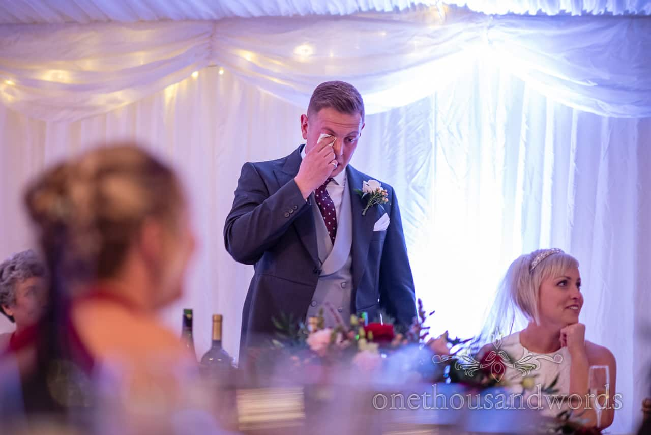 Groom dries his eyes during speech at Smedmore House wedding