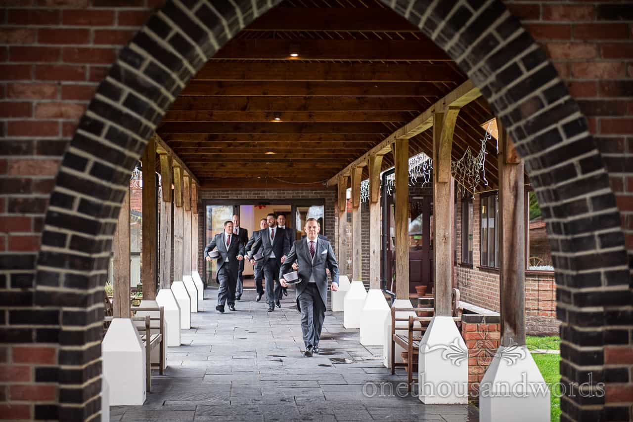 Groom and groomsmen leave hotel for Smedmore House wedding