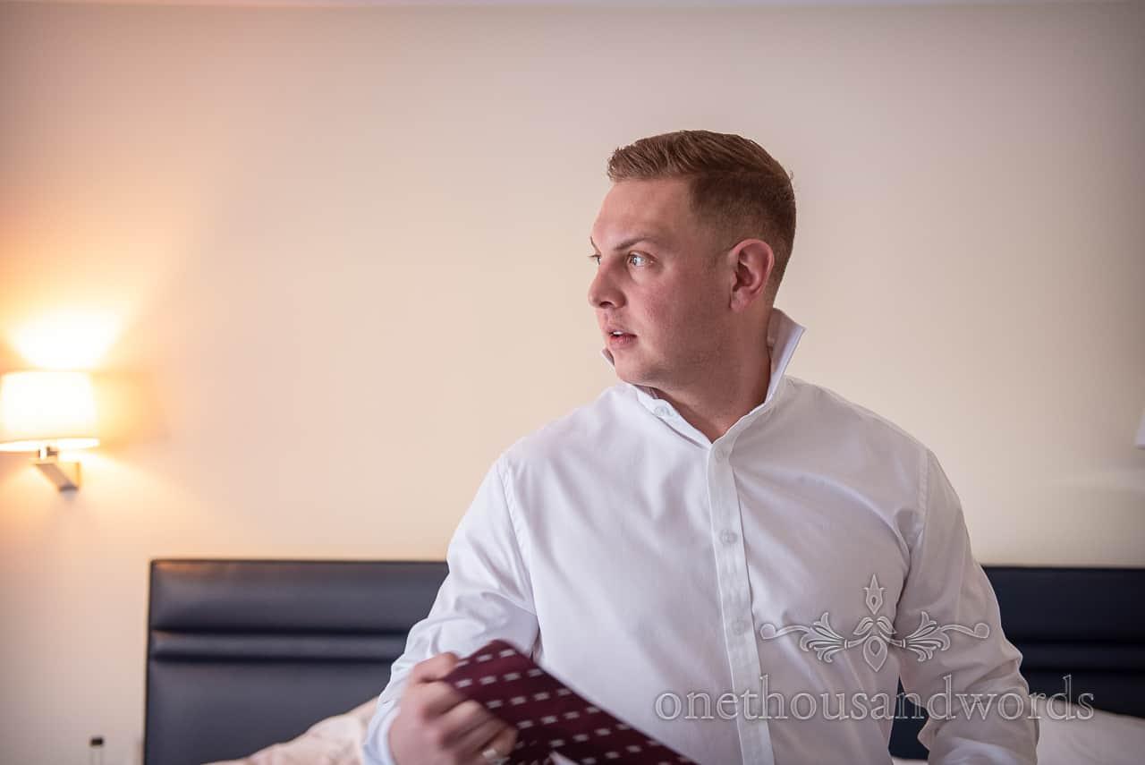 Groom prepares for Smedmore House wedding