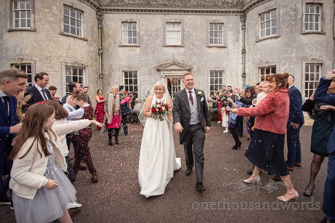 Guests shower newlyweds with confetti Smedmore House wedding