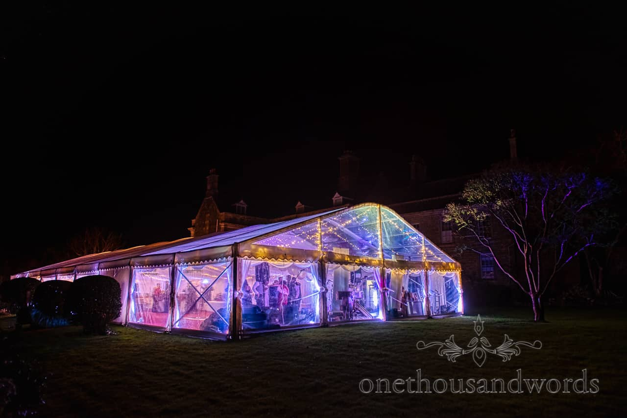 Illuminated wedding marquee in garden at Smedmore House